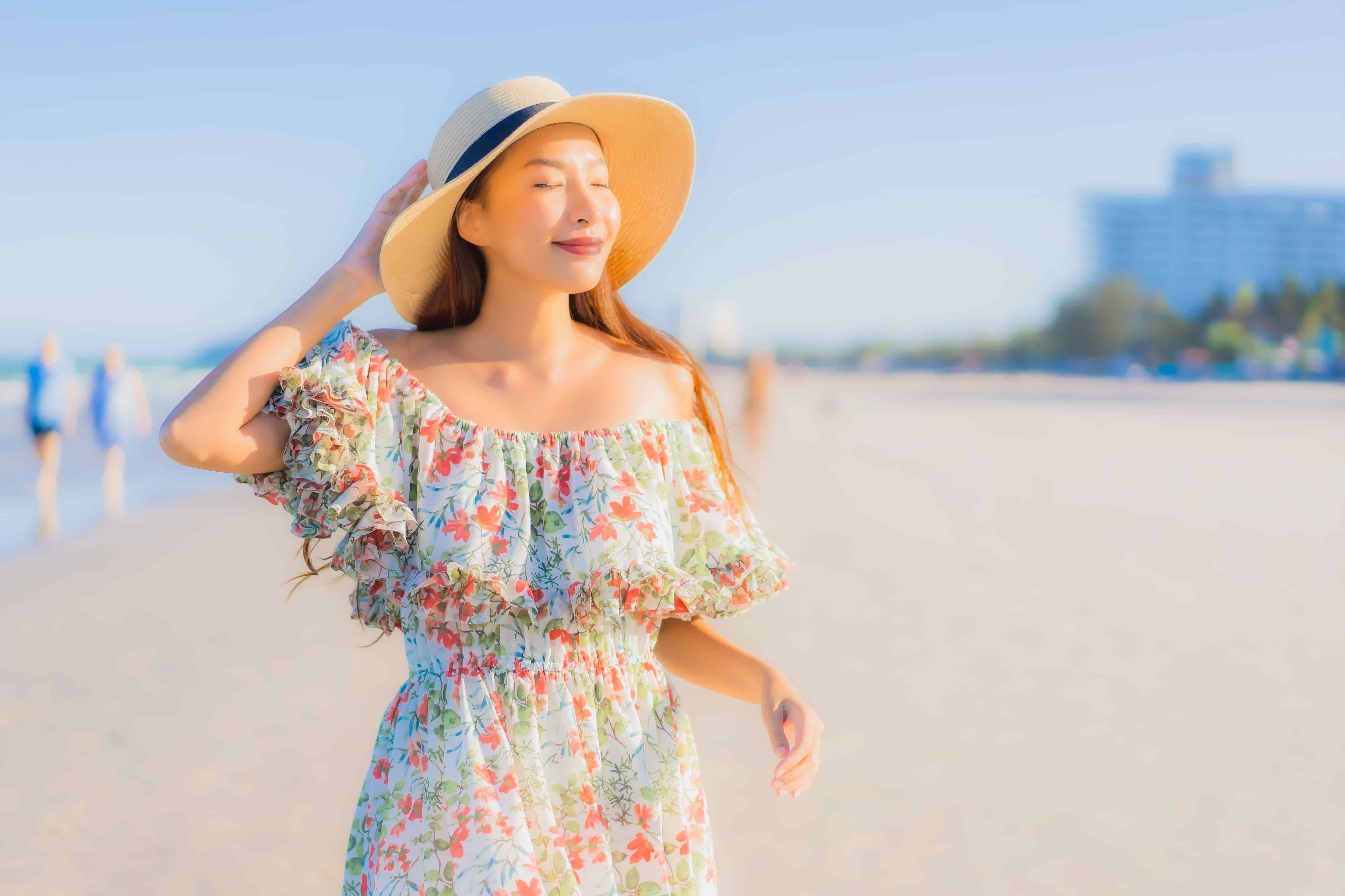 portrait beautiful young asian woman happy smile relax around tropical beach sea ocean min The Pixie Life